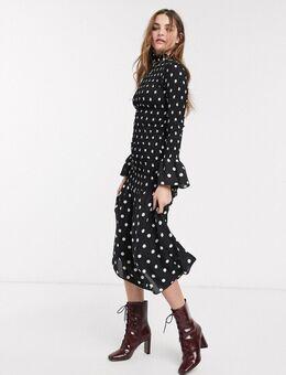 Hoogsluitende lange jurk met stippen-Zwart