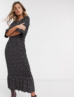 Lange aangerimpelde jurk met peplum zoom en fijne bloemenprint-Zwart